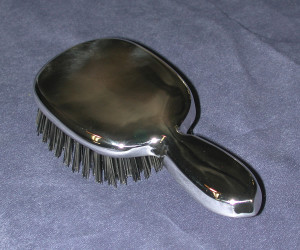 Custom-made Sterling Silver vanity-style hair brush. Hand-fabricated with custom boar hair and maple block brush insert. One of four pieces commissioned.